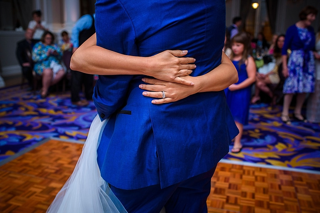 Corinthia Hotel Wedding Photographer bride embracing the groom during the first dance