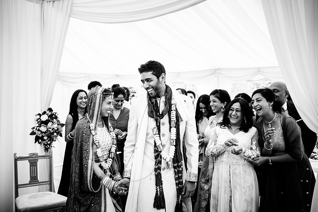 Intimate Surrey Wedding Photography bride and groom and guests having fun during the wedding ceremony