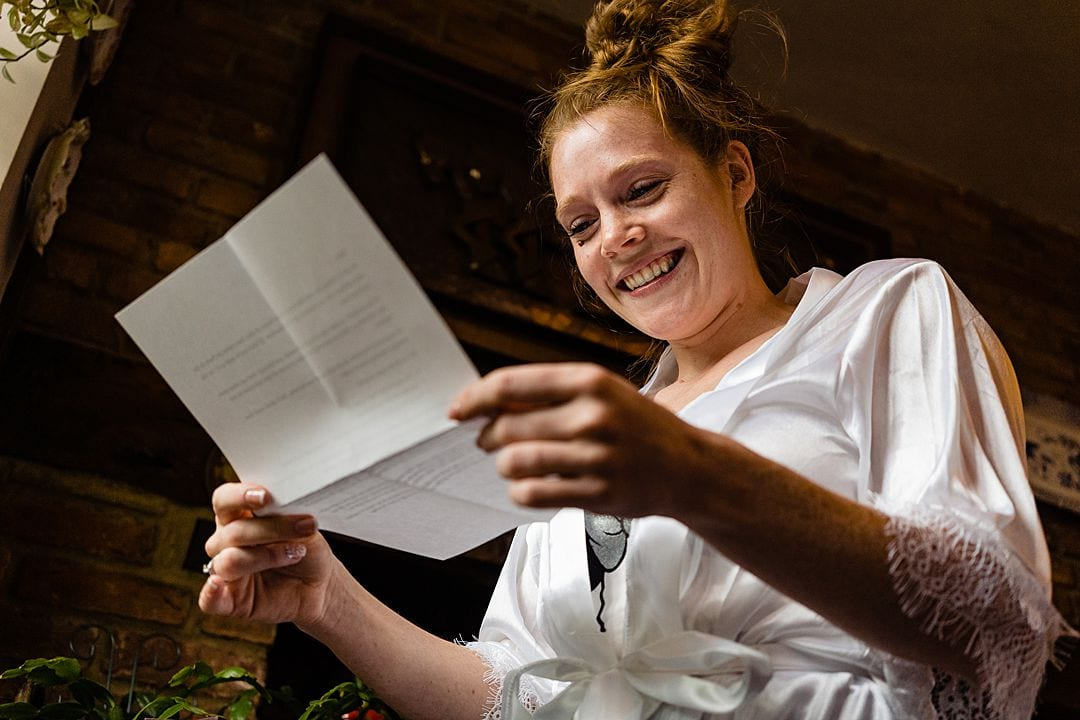 Moor Park Wedding Photography smiling bride reading letter from groom