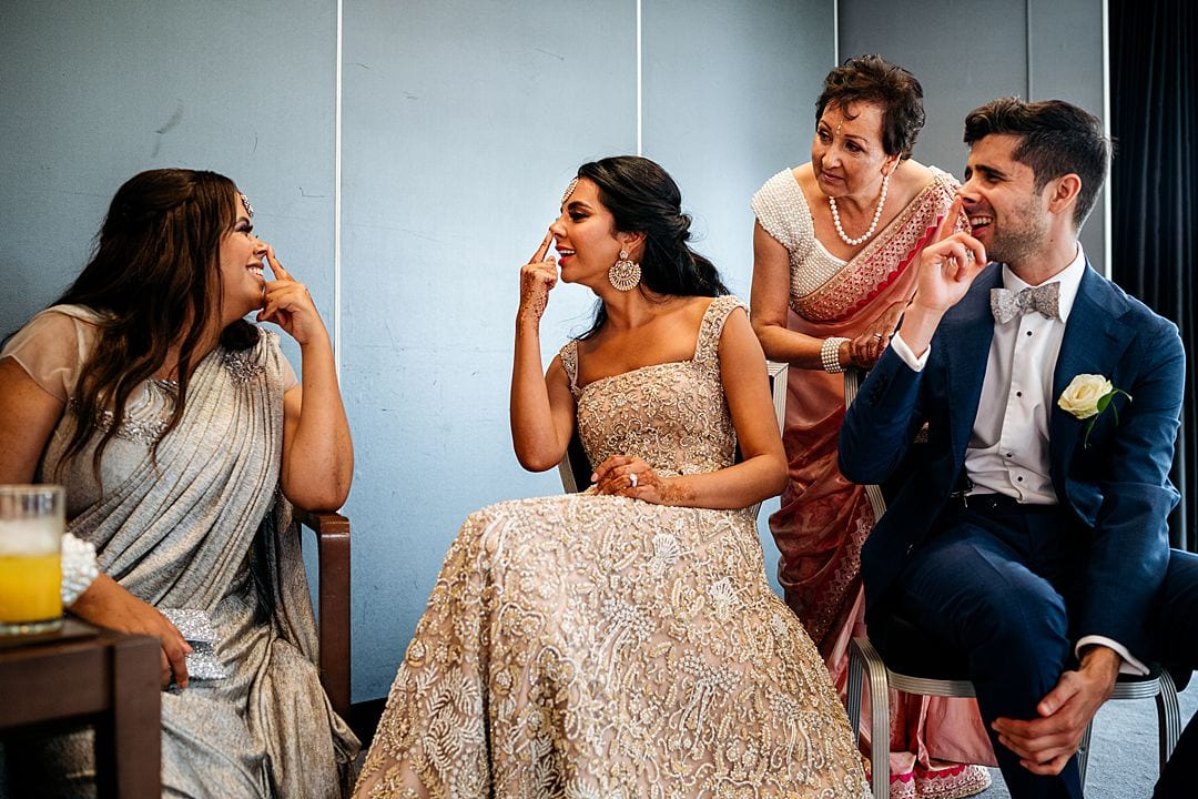 Syon Park Wedding Photography bride playing games with brother and bridesmaid