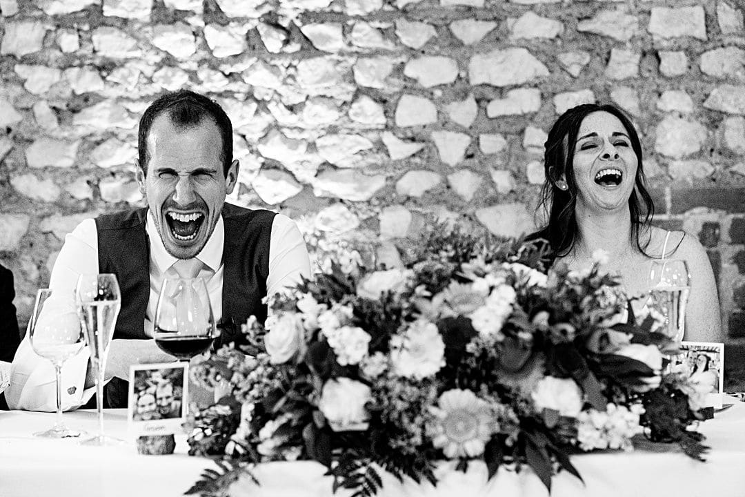 best wedding photography surrey 2019 bride and groom laughing loudly during the speech at farbridge