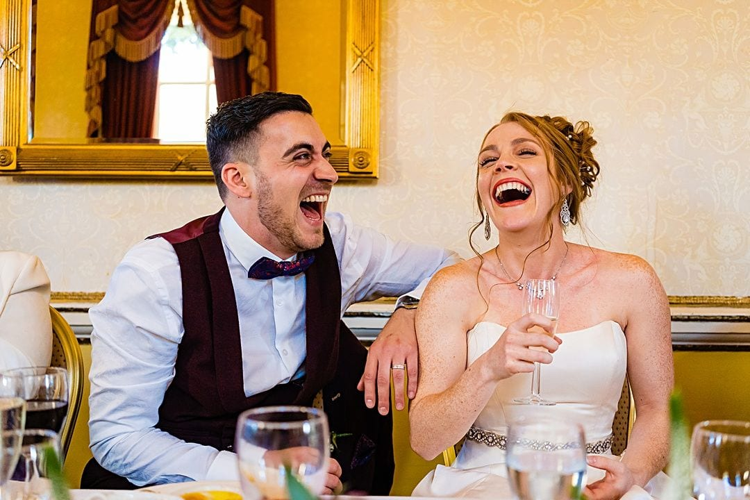 best wedding photography surrey 2019 bride and groom laughing loudly during the speeches at moor park