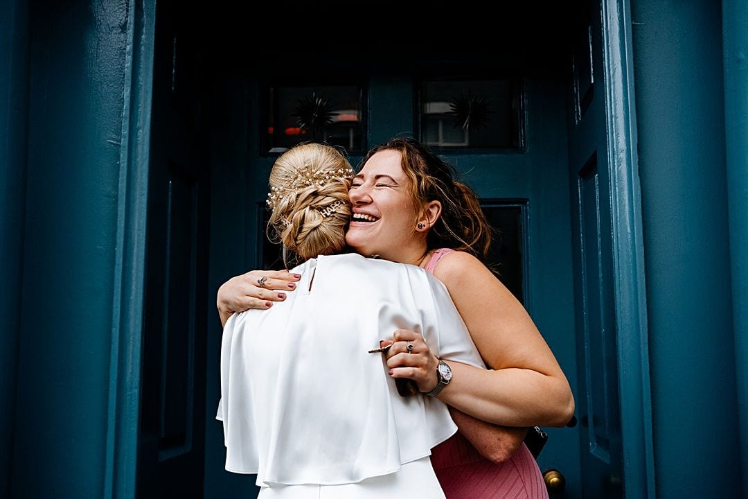 best wedding photography surrey 2019 guest hugging the bride at bingham riverhouse
