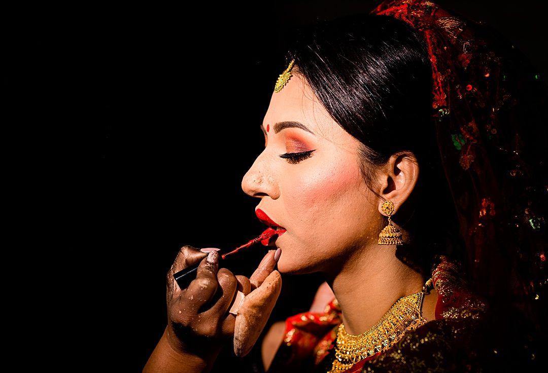 best wedding photography surrey 2019 bride putting make up on in Kathmandu