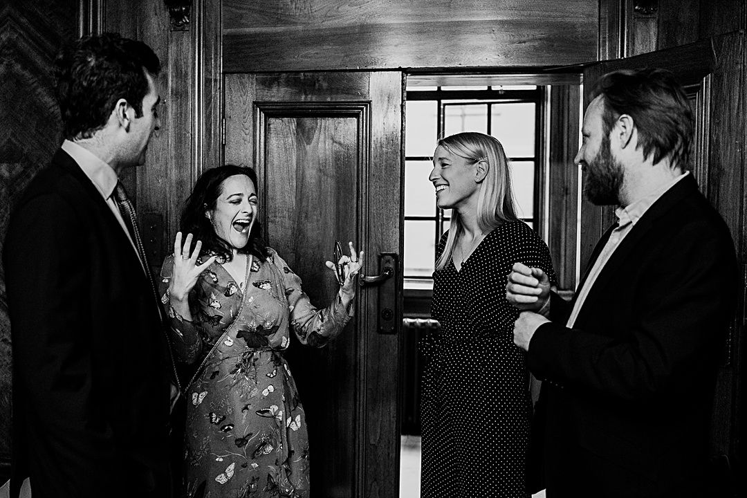 best wedding photography surrey 2019 guests telling stories at old marylebone town hall