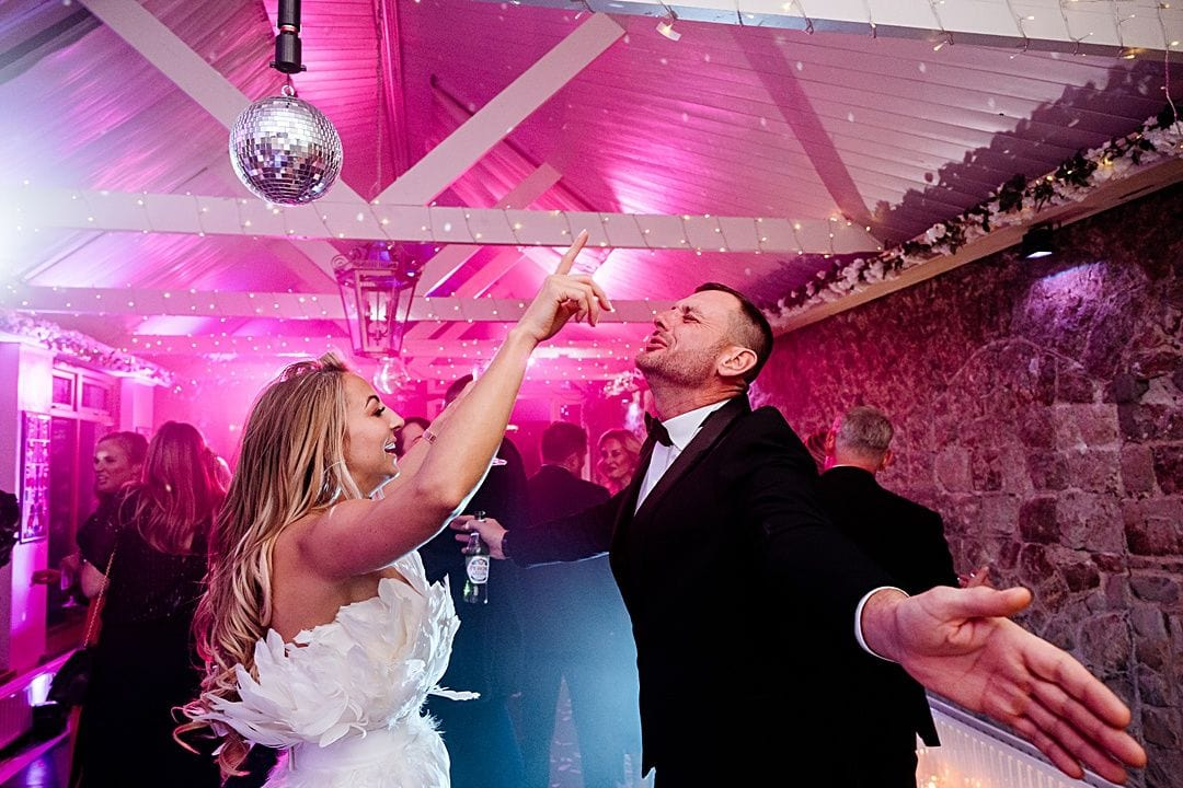 best wedding photography surrey 2019 dancing photo of bride at knowle country house